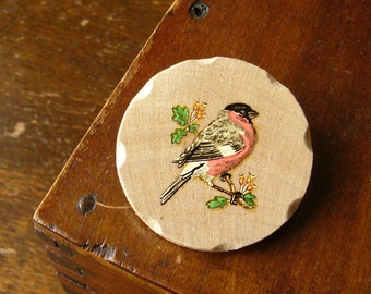 bullfinch on a hawthorn wooden hand shaped brooch