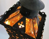 Antique hanging light in heavy iron and had blown glass