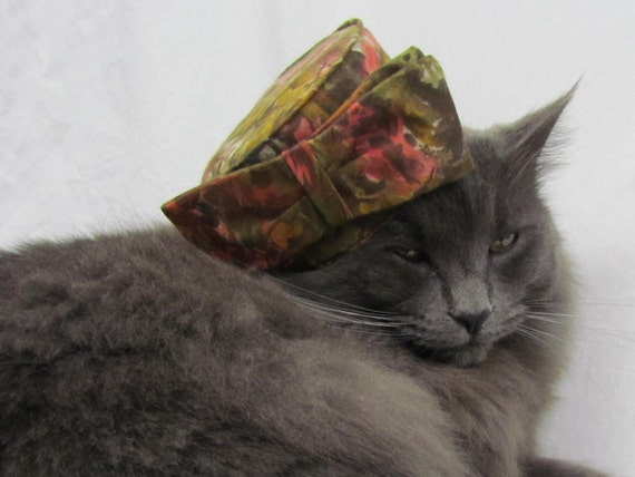 Vintage mini pill box hat in olive green and pink floral, Gracie Cat modeling