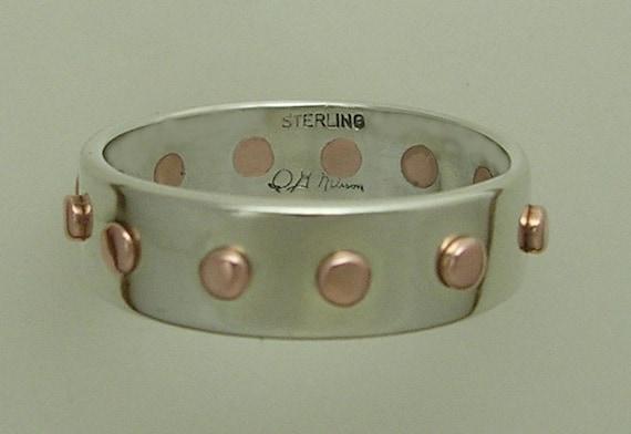 The 12 Rivet Ring