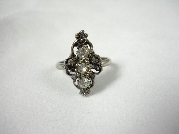 Vintage VogueSilvertone Ring with Clear Three Rhinestones