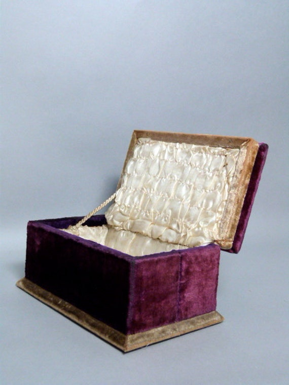 Antique purple velvet box lined in white silk