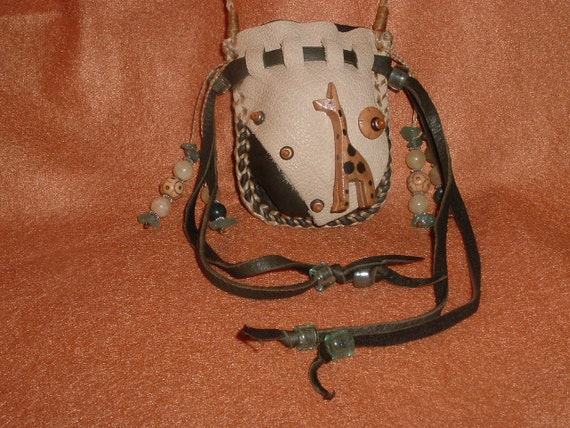 This is(((( reserve for JULIE JAY)))) please don't purchase  deerskin Medicine Bag with a wooden giraffe ((((SALE))))