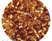 6/0 Topaz Silver Lined Mix Seed Beads - sold in one ounce packs - 480 beads to an ounce - approx 4.0mm diameter - Czech glass beads