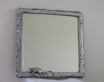 Cast aluminum mirror frame with mouse and foot prints