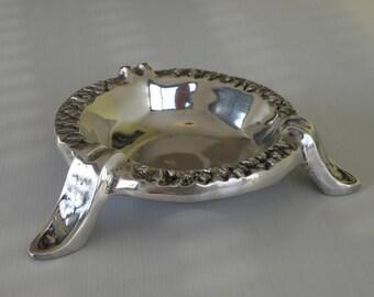 Cast and polished aluminum ashtray
