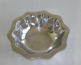 Wavy rim cast and polished aluminum fruit bowl