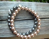 Vintage set of two Faux pearl stretchy bracelets With RMN stamp also formerly known Roman