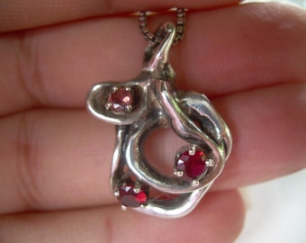 Absolutely stunning One of a kind Man Made Sterling Vintage pendant featuring three Individually pronged Gemstones