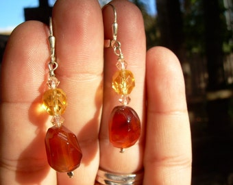Beautiful Pair of Hand made Dangle earrings set in 925 featuring carnelian, and semi precious faceted gemstones.