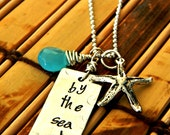 hand stamped by the sea