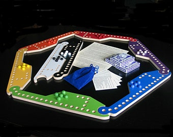 New Marbles and Jokers 8-pc Game with Interlocking paddles.