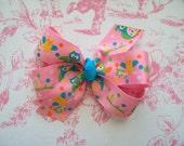 Pink owl pinwheel bow