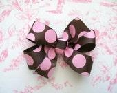 Pink and brown polka dot pinwheel bow