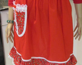 HALF APRON, Holiday/Christmas print/ has red and candy cane accents, with white lace trim ,one pocket