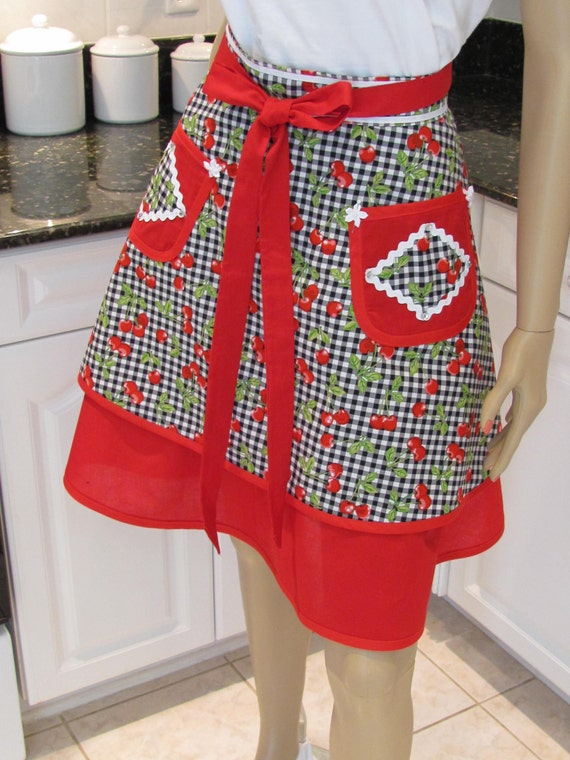Sexy ,Bella Claire half apron in a black and white check print ,with ared cherry motif