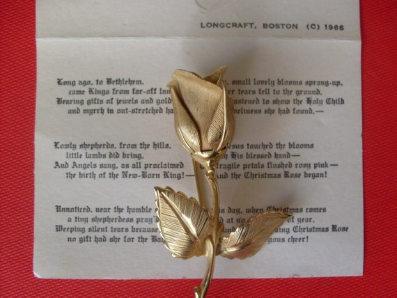 GIOVANNI signing   Legend of the Christmas Rose  brooch with  original box and card that tells about the origin.