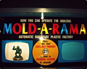 mid-century vintage toys photo, MOLD-A-RAMA, photography, 60s, red, yellow, blue, black, children's room, retro decor, collectibles, Signed
