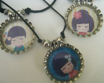 Japan - Kids Saving Kids - Bottlecap necklace featuring Kokeshi Face dolls - Party Pack of 6
