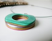 Multicolored Ecofriendly Upcycled Skateboard Donut Pendant on Black Wire Necklace