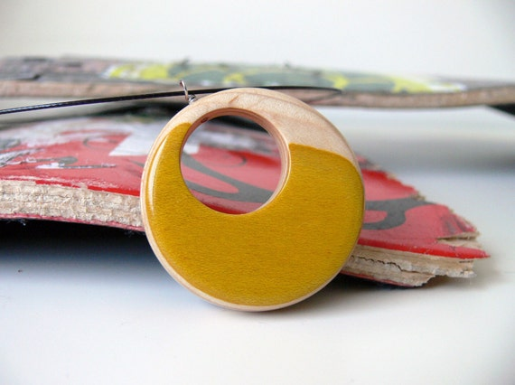 Yellow and Natural Recycled Skateboard Reversible Wood Pendant on a Black Wire Necklace with Black Graphic