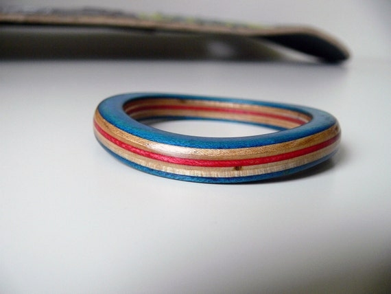Deep Blue, Red and Maple Bracelet Bangle made from Recycled Wooden Skateboard with Black Graphic