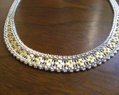 Silver Milor Necklace with Gold Trim