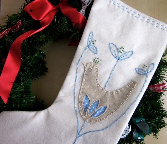 A Christmas stocking in Scandinavian style with applique felt bird