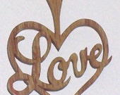 Scroll saw cut wooden ornament that says Love--106c