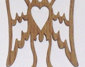 Scroll saw cut angel with a heart ornament--1c