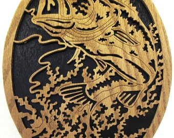 Fish jumping in an oval scroll saw cut--6fr
