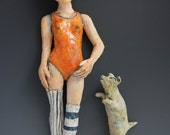 Gym Socks and girl and her dog: Wall sculptures by ceramic artist Victoria Rose Martin