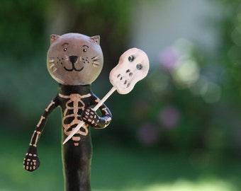 Skeleton Cat Trick-Or-Treater Figurine