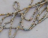 antique french steel bead strand  bright gold cuts and rounds