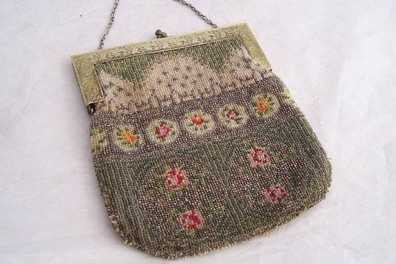 Antique beaded handbag with Ornate glass beaded design Heavy frame Well made