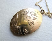 Oversized vintage oval gold locket necklace on long 14k gold chain, signed LeStage jewelry