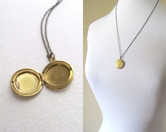Round vintage locket, etched on delicate antiqued brass chain