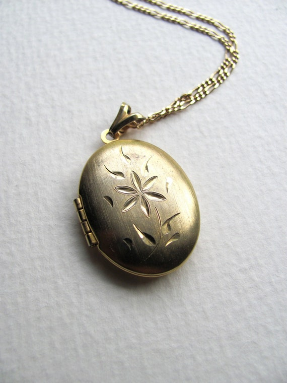 Vintage etched oval gold locket necklace on long GF figaro chain