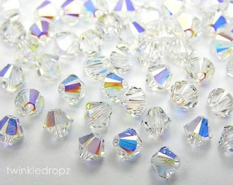 35 pcs Clear CRYSTAL AB Swarovski Bicone Beads 5328 6mm Wholesale Destash