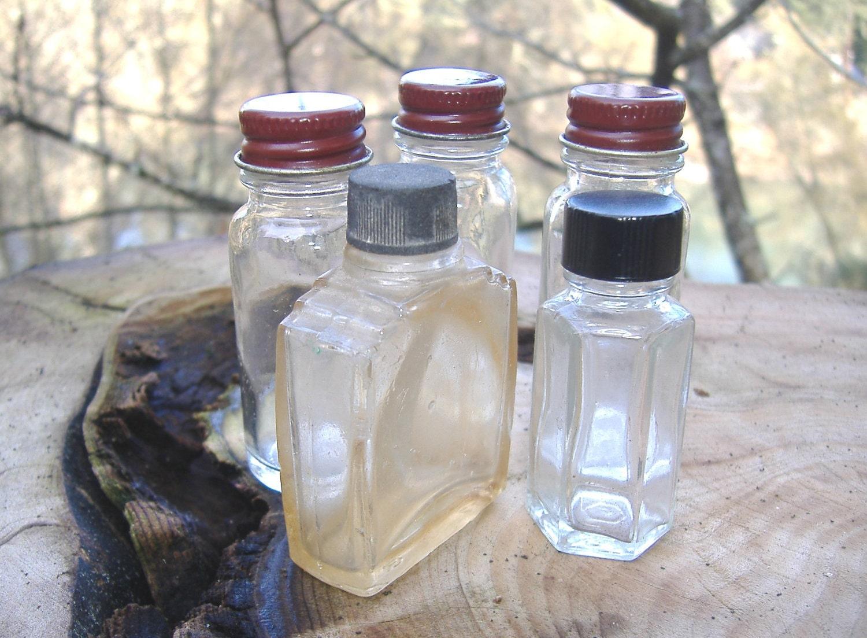 5 small old glass bottles screw on lids. Black Bedroom Furniture Sets. Home Design Ideas