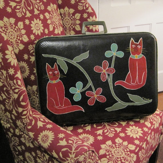 Two Cats on a Green Suitcase