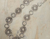 Sterling silver long wheels necklace.