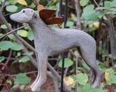 carved greyhound
