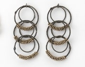 Beaded Twisted Wire Long Circle Earrings on etsy