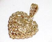 10kt yellow gold heart pendant w/ filigree diamond cut accent design