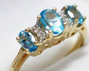 Blue topaz gemstone ring band solid 10k yellow gold diamond accent size sz 5.75 3 stone setting womens fine jewelry