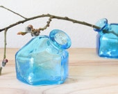pair of antique PAR-A-SOL aqua inkwells