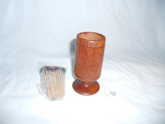 This is a one-of akind teak toothpick holder for your table or bar.