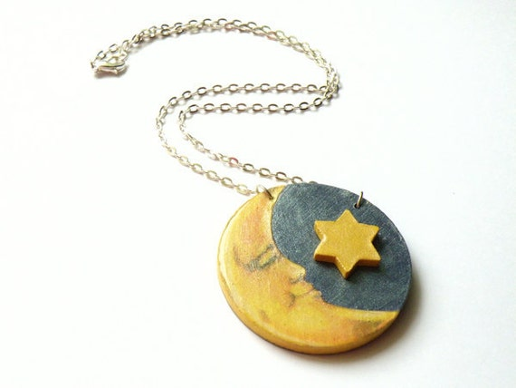 Wooden necklace with moon pendant and a little wooden star on shiny silver chain