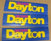 Discover Dayton Ohio, vintage bumper sticker ohio the heart of it all, blue yellow magenta